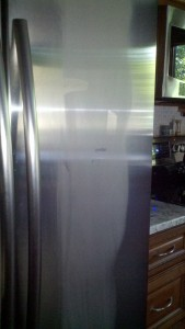 Refrigerator door with frost on a humid day - is there enough insulation?